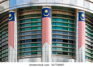 Malaysia Flag on modern building in in Kuala Lumpur, Malaysia.Malaysia is a member of Asean Economic Community (AEC)