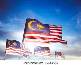 Malaysia flags waving with pride on a sunny day / high contrast image