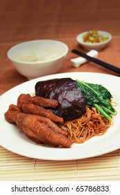 Malaysia Food: dried wanton noodle with chicken feet and mushroom