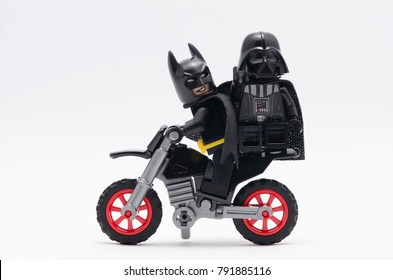malaysia, Jan 1, 2018. batman riding dirt bike with darth vader on her back. Lego minifigures are manufactured by The Lego Group.