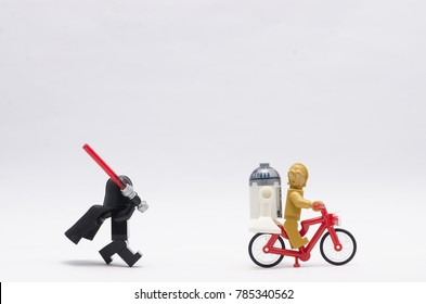 malaysia, Jan 1, 2018. darth vader chasing r2d2 and c3po . Lego minifigures are manufactured by The Lego Group.