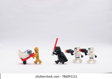 malaysia, Jan 1, 2018. darth vader with  storm troopers chasing c3po with r2d2 sitting on trolley. Lego minifigures are manufactured by The Lego Group.