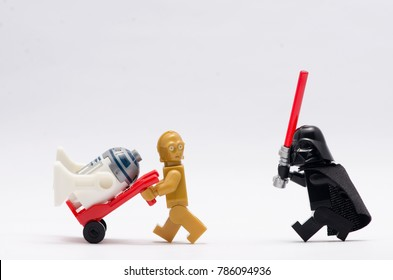 malaysia, Jan 1, 2018. darth vader chasing c3po with r2d2 sitting on trolley. Lego minifigures are manufactured by The Lego Group.