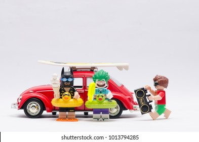 MALAYSIA, jan 21, 2018. batman, joker and robin  with radio going on vacation with volkswagen beetle car. Lego minifigures are manufactured by The Lego Group.