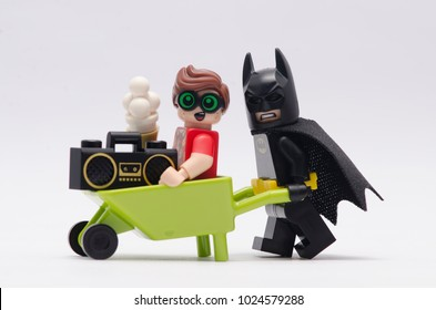 MALAYSIA, jan 21, 2018.  batman pushing wheelbarrow with robin sitting on it. Lego minifigures are manufactured by The Lego Group.