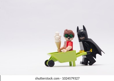 MALAYSIA, jan 21, 2018.  batman pushing wheelbarrow with robin with ice cream sitting on it. Lego minifigures are manufactured by The Lego Group.