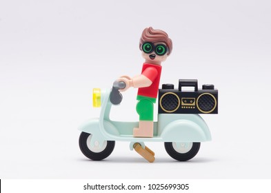 MALAYSIA, jan 21, 2018. beach robin riding scooter with radio at his back. Lego minifigures are manufactured by The Lego Group.