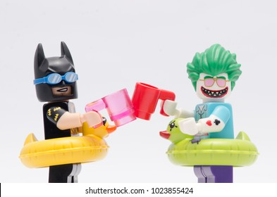 MALAYSIA, jan 21, 2018.  close up vacation batman and joker having a drink. Lego mini figures are manufactured by The Lego Group.