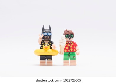MALAYSIA, jan 21, 2018. vacation batman and robin holding icecream. Lego minifigures are manufactured by The Lego Group.