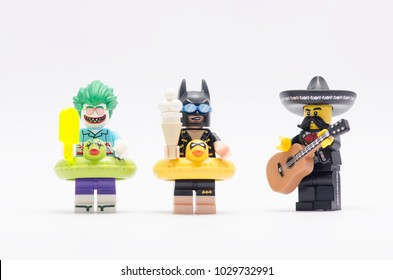 MALAYSIA, jan 21, 2018.  vacation batman and joker holding ice cream with mariachi playing the guitar. Lego minifigures are manufactured by The Lego Group.