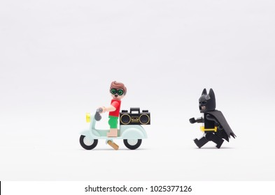 MALAYSIA, jan 21, 2018.batman chasing beach robin riding scooter with radio at his back. Lego minifigures are manufactured by The Lego Group.