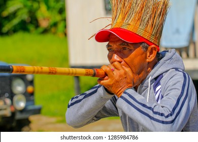 "Malaysia - January 15, 2019 : ""Sumpit"" or traditional blow gun tournament in Gua Musang, Malaysia. Sumpit (blow gun) is Indigenous Malaysians weapon, for hunting and even for defensive weapon."