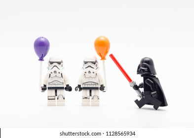 MALAYSIA, jul 01, 2018. lego  darth vader watching storm troopers holding a balloon. Lego minifigures are manufactured by The Lego Group.
