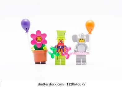 MALAYSIA, jul 01, 2018. lego  mini figure flower pot girl, elephant girl and party clown holding ballon from series 18. Lego minifigures are manufactured by The Lego Group.
