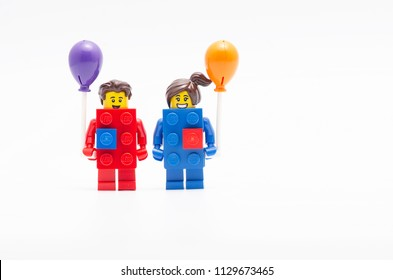 MALAYSIA, jul 01, 2018. lego red and blue brick holding a balloon . Lego minifigures are manufactured by The Lego Group.