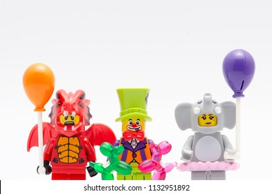 MALAYSIA, jul 01, 2018. lego dragon suit guy, party clown and elephant suit girl with balloons. Lego minifigures are manufactured by The Lego Group.