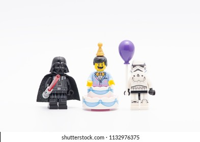 MALAYSIA, jul 01, 2018. lego darth vader with party cake man and storm troopers holding a balloon. Lego minifigures are manufactured by The Lego Group.