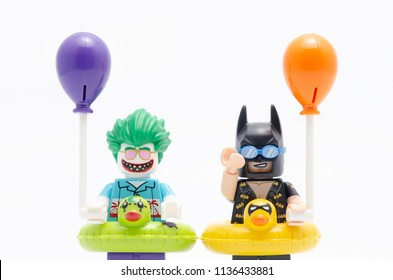 MALAYSIA, jul 15, 2018. vacation batman and joker holding a balloon. Lego minifigures are manufactured by The Lego Group.