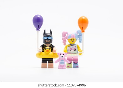 MALAYSIA, jul 15, 2018. vacation batman with n-pop girl holding balloon. Lego minifigures are manufactured by The Lego Group.