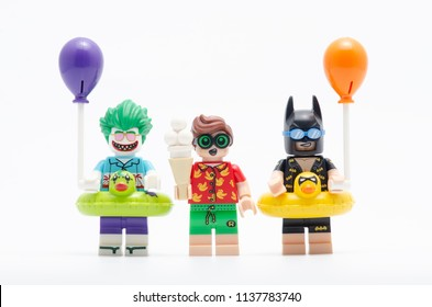 MALAYSIA, jul 15, 2018. vacation batman and joker holding a balloon with robin. Lego minifigures are manufactured by The Lego Group