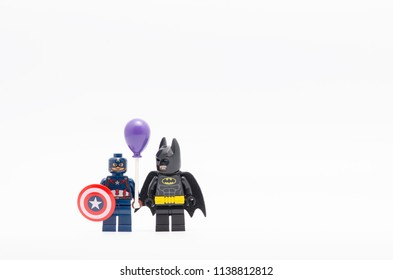 MALAYSIA, jul 19, 2018. batman watching captain america holding balloon. Lego minifigures are manufactured by The Lego Group.