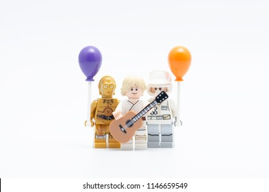 MALAYSIA, jul 19, 2018. Lego luke skywalker holding guitar with rebel army and c3p0 holding balloon. Lego minifigures are manufactured by The Lego Group.