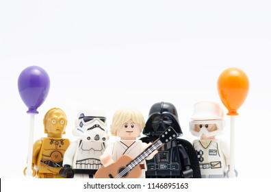 MALAYSIA, jul 19, 2018. Lego luke skywalker holding guitar withdarth vader, storm trooper, rebel army and c3p0 holding balloon. Lego minifigures are manufactured by The Lego Group.