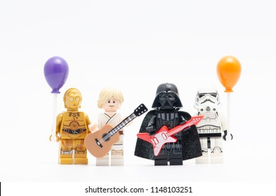 MALAYSIA, jul 19, 2018. Lego luke skywalker  and darth vader holding guitar with storm trooper and c3p0 holding balloon. Lego minifigures are manufactured by The Lego Group.