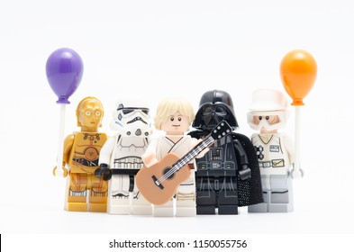 MALAYSIA, jul 19, 2018. Lego luke skywalker holding guitar with darth vader, storm trooper and c3p0 holding balloon. Lego minifigures are manufactured by The Lego Group.