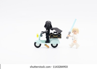 MALAYSIA, jul 19, 2018. luke skywalker chasing darth vader riding scooter. Lego minifigures are manufactured by The Lego Group.