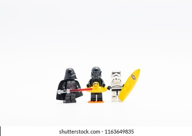 MALAYSIA, jul 30, 2018. Lego darth vader, death trooper and storm troopers holding surfing board. Lego minifigures are manufactured by The Lego Group.