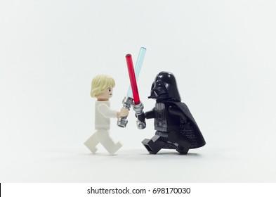 malaysia, july 09, 2017. lego darth vader fighting luke skywalker . isolated on white background.