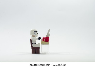 Malaysia, july 11, 2017. lego storm trooper sitting in front of computer . Lego minifigures are manufactured by The Lego Group.