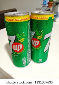 Malaysia, July 11th, 2018 - Refreshing carbonated 7UP drinks in cans isolated in white