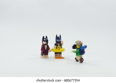 Malaysia, july 19, 2017. lego hiker taking picture of vacation batman and Lobster Lovin' Batman. Lego minifigures are manufactured by The Lego Group.