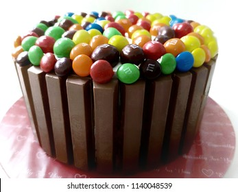 MALAYSIA - JULY 21, 2018: A cake made from kitkat and MnM chocolates for birthday party on midnight