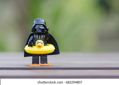 malaysia, july 22, 2017. lego darth vader wearing bobbin' floatie ring and  flippers ready to go swimming.  Lego minifigures are manufactured by The Lego Group.