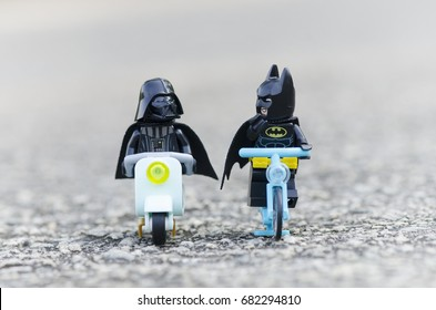 malaysia, july 22, 2017. lego darth vader riding scooter along with batman riding bicycle.  Lego minifigures are manufactured by The Lego Group.