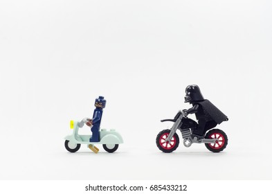 malaysia, july 27, 2017. lego darth vader riding dirt bike chasing captain america with scooter. Lego minifigures are manufactured by The Lego Group.