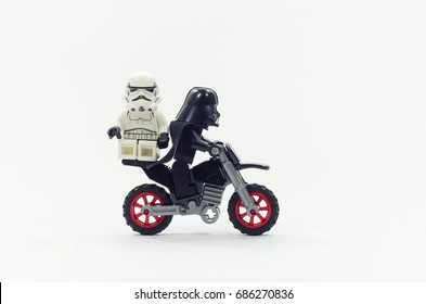 malaysia, july 28, 2017.closeup lego darth vader riding dirt bike with storm trooper at the back. Lego minifigures are manufactured by The Lego Group.
