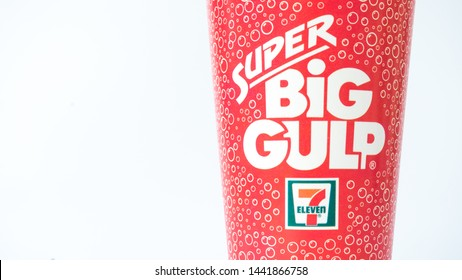 Malaysia - July 4, 2019: 7-Eleven Super Big Gulp cups - 7-Eleven is the world's largest operator, franchiser, and licensor of convenience stores with more than 50,000 outlets.