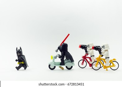 malaysia, july 6, 2017. lego darth vader and stormtroopers chasing lego batman, isolated on white background. Lego minifigures are manufactured by The Lego Group.