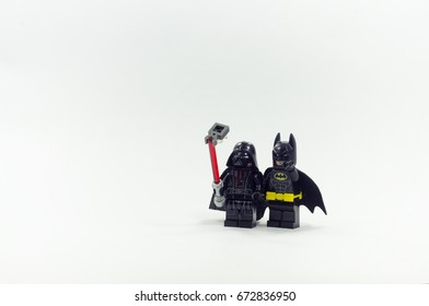 malaysia, july 6, 2017. lego darth vader taking selfie with lego batman minifigures. Lego minifigures are manufactured by The Lego Group.