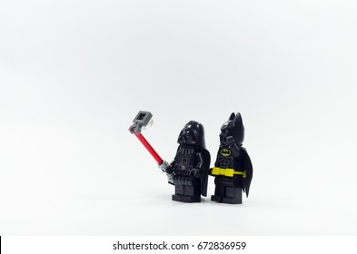 malaysia, july 6, 2017. lego darth vader taking photo with lego batman minifigures. Lego minifigures are manufactured by The Lego Group.