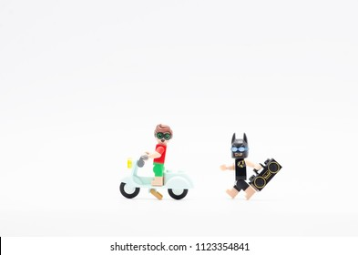 MALAYSIA, jun 28, 2018. batman with radio chasing robin riding a scooter. Lego minifigures are manufactured by The Lego Group.