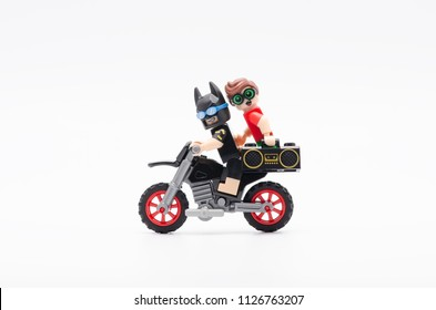 MALAYSIA, jun 28, 2018. batman riding motorcycle with robin holding radio. Lego minifigures are manufactured by The Lego Group.