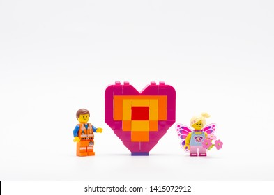 Malaysia, june 02, 2019. lego emmet with butterfly girl and piece offering heart shape.  Lego minifigures are manufactured by The Lego.