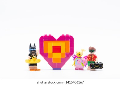 Malaysia, june 02, 2019. lego batman with butterfly girl and robin and piece offering heart shape.  Lego minifigures are manufactured by The Lego.