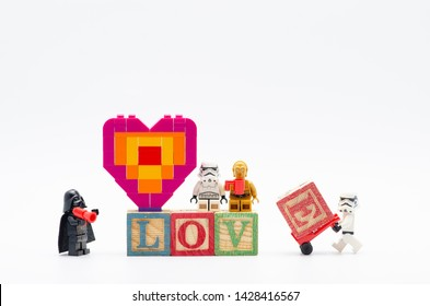 Malaysia, june 02, 2019. lego darth vader giving order assembling word love with piece offering heart shape.  Lego minifigures are manufactured by The Lego.