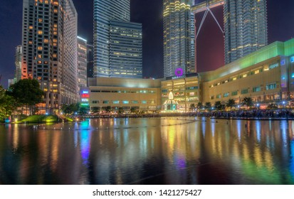 MALAYSIA, Kuala Lumpur : 06 JUNE 2019 - Beautiful colorful musical fountain at night with background of Petronas Twin Tower and Suria KLCC. Petronas Twin Tower is the tallest building in Malaysia